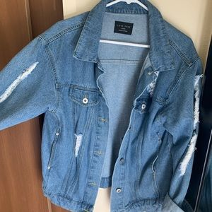 Blue torn denim jacket
